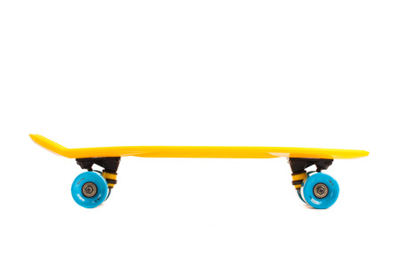 yellow penny skateboard, isolated on white Stock Photo