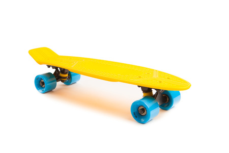 isolated on yellow: yellow penny skateboard, isolated on white Stock Photo