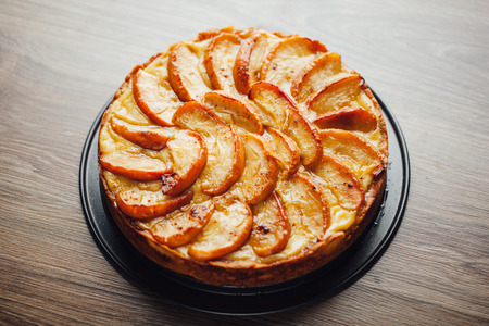 table top: apple tart cake on wooden table top