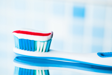 red stripe: blue toothbrush with red stripe toothpaste