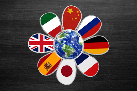 international flags: language flower with international flags as petals, chalk draw on blackboard Stock Photo