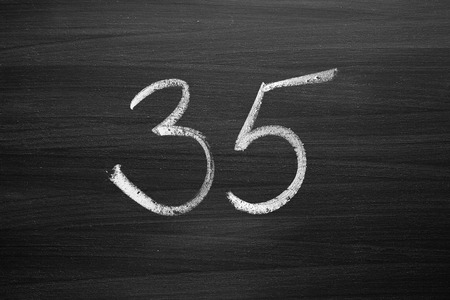 thirty five: number thirty five enumeration written with a chalk on the blackboard
