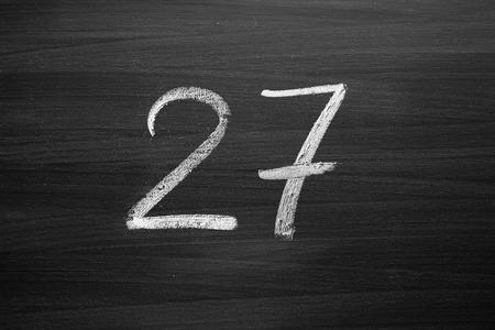 number twenty seven enumeration written with a chalk on the blackboard