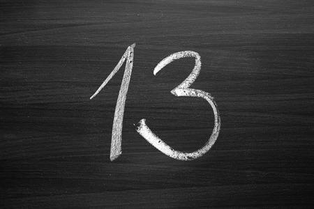 thirteen: number thirteen enumeration written with a chalk on the blackboard Stock Photo