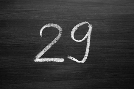 number twenty nine enumeration written with a chalk on the blackboard