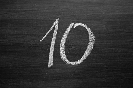 number ten: number ten enumeration written with a chalk on the blackboard Stock Photo
