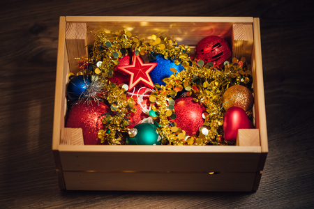 stored: Christmas decorations stored in wooden box Stock Photo