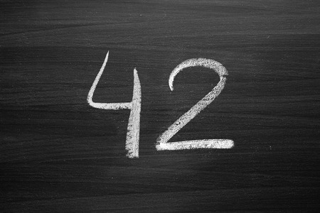 number forty two enumeration written with a chalk on the blackboard Stock Photo