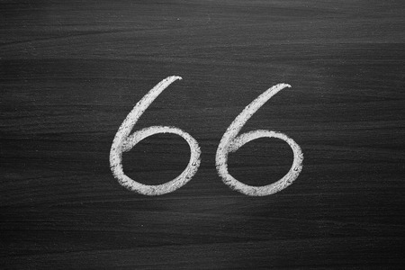sixty six: number sixty six enumeration written with a chalk on the blackboard