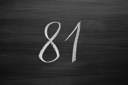 81: number eighty one enumeration written with a chalk on the blackboard