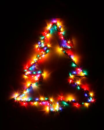 Christmas Tree Shape Of Multicolor Garland Lights Photo