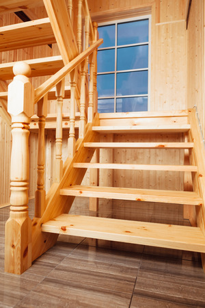 handrail: staircase and window inside of wooden house