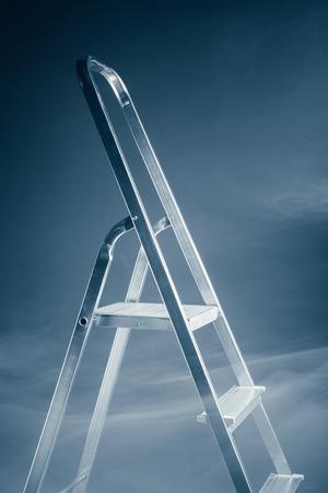 metallic stairs: folding ladder in smoke Stock Photo