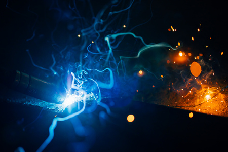 spark: artistic welding sparks light, industrial background Stock Photo