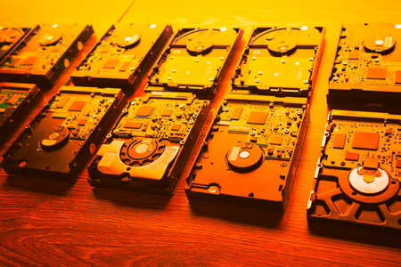 hard disk drives in a rows, warm orange tone Stock Photo
