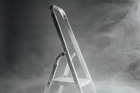 folding ladder in smoke Stock Photo