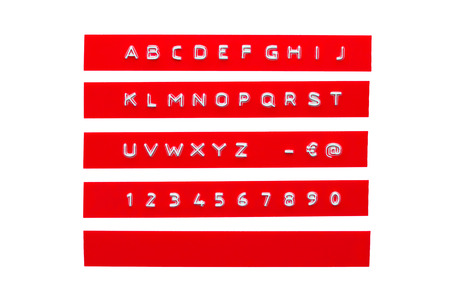 embossed alphabet on red plastic tape, isolated on white