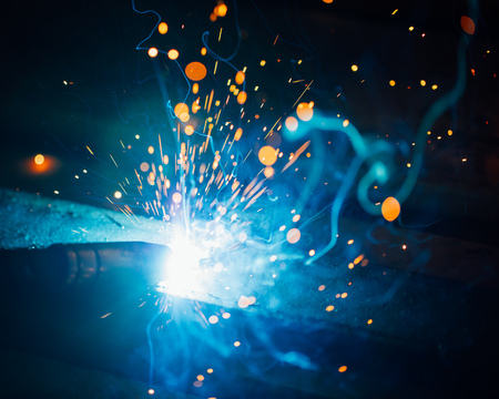 芸術的な溶接火花光産業の背景 写真素材