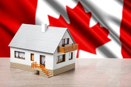 classic house against Canada flag background