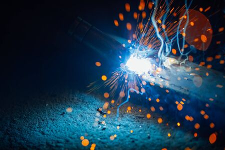 artistic welding sparks light, industrial background Stock Photo