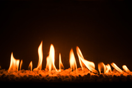 gas fireplace: gas fireplace with pebble crushed stones Stock Photo