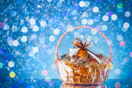 gift basket with festive particles, blue background