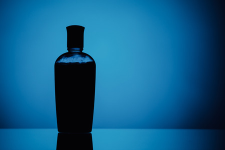 shower gel silhouette on blue background Stock Photo