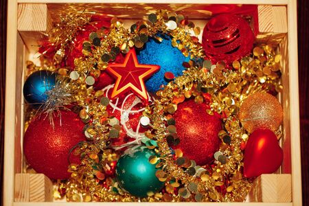 Christmas decorations stored in wooden box, top view