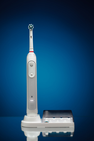 prophylaxis: electric toothbrush on blue background