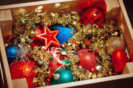 Christmas decorations stored in wooden box Stock Photo