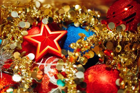 Christmas decorations mixed in storage box Stock Photo