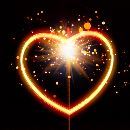 heart light with sparks background Stockfoto