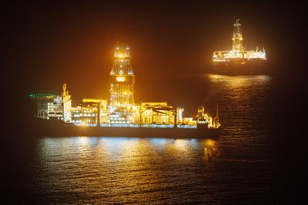offshore oil drillship at night Stock Photo