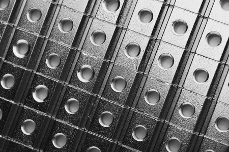 slide screw nuts in a row, abstract industrial background