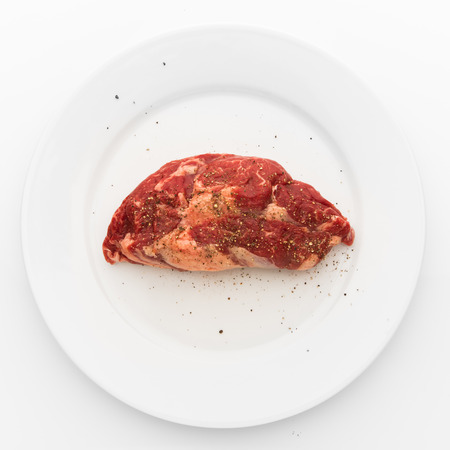fresh beef meat on white plate