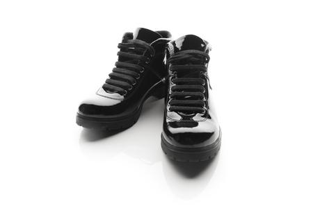 black varnished patent leather shoes isolated on white Reklamní fotografie