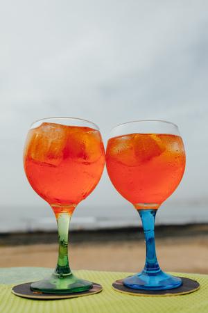 glasses with orange alcohol spritz cocktail