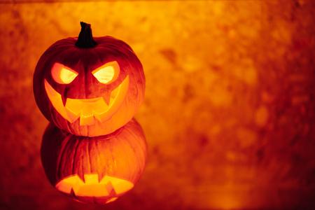jack-o-lantern pumpkin orange light, Halloween background Stock Photo