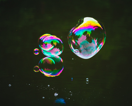 soap bubbles on lake water surface