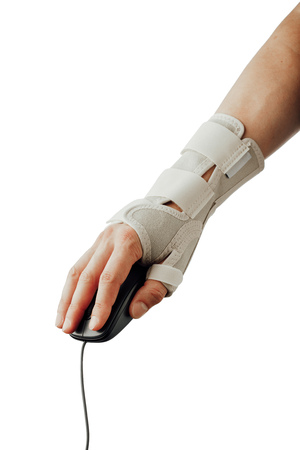 wrist and hand orthotics support for carpal tunnel syndrome healing, isolated on white