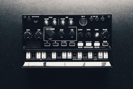 black analog synthesizer, close-up view