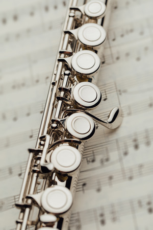 transverse flute on music sheet