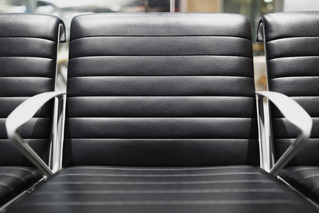 black leather chair in airport terminal Banco de Imagens - 116436337