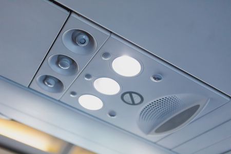 overhead light and air conditioner in airplane cabin