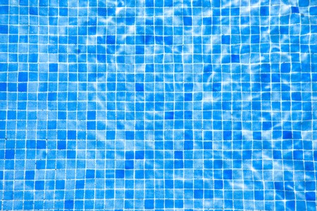 water and blue tile in swimming pool Stock Photo