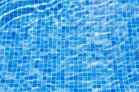 water ripples in swimming pool, blue background