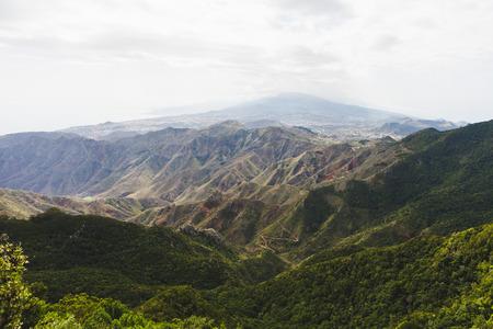 mountains in Anaga rural park, Teide volcano background, Tenerife