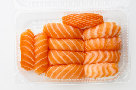 sashimi sushi set in a plastic box container