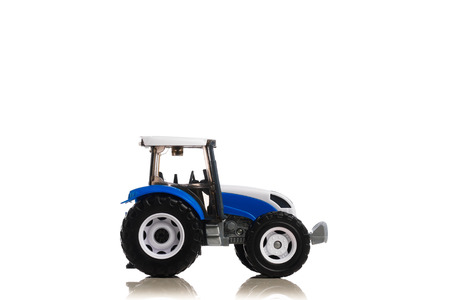 farm tractor toy, isolated on white Фото со стока - 123075663