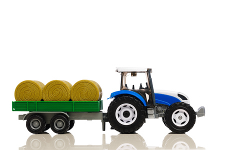 farm tractor toy with hay trailer, isolated on white Фото со стока - 123075720